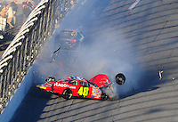 Feb 6, 2010; Daytona Beach, FL, USA; ARCA RE/MAX Series driver Jill George (48) flips over and crashes in front of Jesse Smith (29) during the Lucas Oil Slick Mist 200 at Daytona International Speedway. Mandatory Credit: Mark J. Rebilas-
