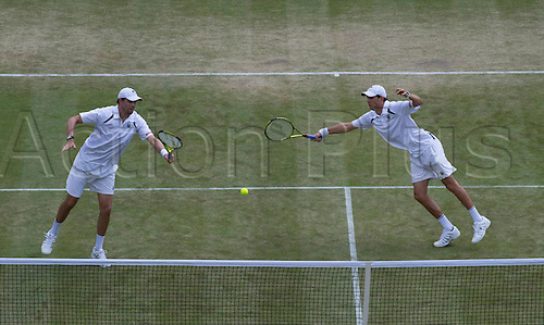 01.07.2011. Wimbledon, London.  Gentlemen's Doubles - Semifinals. Bob Bryan USA (1)  & Mike Bryan USA (1) def Michael Llodra FRA (6) & Nenad Zimonjic SRB .  The Wimbledon Tennis Championships held at The All England Lawn Tennis and Croquet Club. WIMBLEDON TENNIS CHAMPIONSHIPS - Day Twelve