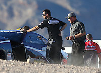Mar 28, 2014; Las Vegas, NV, USA; NHRA pro stock driver Vincent Nobile (left) with an NHRA tech official during qualifying for the Summitracing.com Nationals at The Strip at Las Vegas Motor Speedway. Mandatory Credit: Mark J. Rebilas-