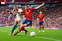 01.08.2012 Manchester, England. Spain defender Jordi Alba and Morocco forward Soufiane Bidaoui in action during the third round group D mens match between Spain and Morocco at Old Trafford.
