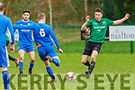 Mike Hanafin CAstleisland tackles the Killarney Athletic midfielder in Killarney on Sunday