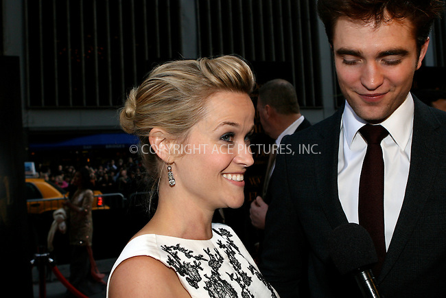 WWW.ACEPIXS.COM . . . . .  ....April 17 2011, New York City....Actors Robert Pattinson and Reese Witherspoon arriving at the 'Water For Elephants' premiere at the Ziegfeld Theatre on April 17, 2011 in New York City.....Please byline: NANCY RIVERA- ACEPIXS.COM.... *** ***..Ace Pictures, Inc:  ..Tel: 646 769 0430..e-mail: info@acepixs.com..web: http://www.acepixs.com