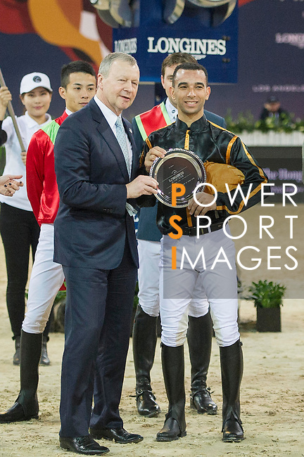 Team magic: Rider Roger-Yves Bost of France and Jockey Joao Moreira of Brazil win the Hong Kong Jockey Club Race of the Riders, part of the Longines Masters of Hong Kong on 10 February 2017 at the Asia World Expo in Hong Kong, China. Photo by Juan Serrano / Power Sport Images