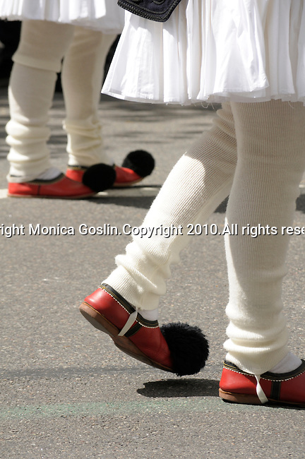 Greek Parade in New York City. Detail of men's red shoes and costumes in the Greek Parade in New York City.