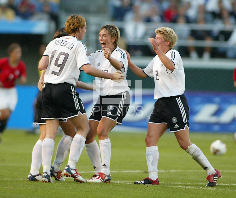 Germany celebrates win over the USA in the Semi-Finals,  2003 WWC. Germany 3-0.