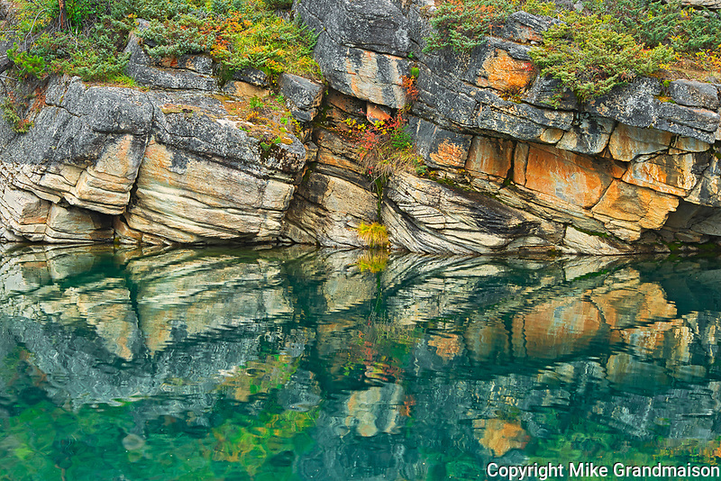Reflection of shoreline rocks in Horseshoe Lake<br />