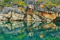 Reflection of shoreline rocks in Horseshoe Lake<br />Jasper National Park<br />Alberta<br />Canada