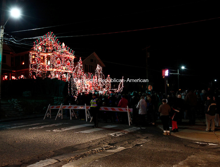 """Torrington, CT- 29 November 2013-112913CM07- Ron Merriman's home lights up on Main Street in Torrington Friday night.  A large crowd of people turned out for """"Light Up Main"""", which featured tree lightings, a living nativity and a Christmas House.  Christopher Massa Republican-American"""