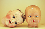 Two cracked doll heads