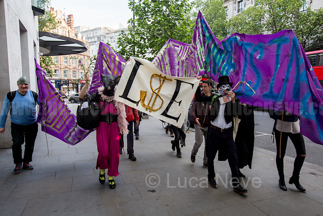 &quot;You can imprison us but the real crime is inequality&quot;.<br /> <br /> London, 10/05/2017. Today &quot;Life Not Money at the LSE&quot; held a demonstration outside the London School of Economics and Political Science to protest against &quot;the pay and conditions of the lowest paid workers at the school&quot;. From the organiser Facebook event page: &lt;&lt;Noam Chomsky has send us a message to say the campaign is &quot;important and courageous&quot;. [&hellip;] The Life not Money campaign demand for a significant &pound;100,000 cut in LSE director&rsquo;s pay and the money to be used improve the pay and conditions of the lowest paid workers at the school. The last director got around &pound;500,000 while some workers get as little as &pound;8/hour taking into account unpaid breaks. The UVW trade union campaign has exposed a trail of abuse and humiliation experienced by LSE cleaners while the schools excludes working class students so as to accept the off springs of the world's elites. Public institutions such as LSE should be accountable to the general public not a get rich quick scheme for corporate managements. This protest is part of a series of creative events involving the decorating of walls with flowers and balloons and statements. [&hellip;] There have also been peaceful acts of open civil disobedience &ndash; putting washable chalk on the buildings which has led to arrests and bail conditions. [&hellip;] Life not Money is a pop up public campaign to bring people together who are want to take effective and creative action on gross inequality and corruption in our public institutions [&hellip;]&gt;&gt;. The main banner of the protest stated: &quot;You can imprison us but the real crime is inequality&quot;.<br /> <br /> For more information please click here: https://www.facebook.com/events/291063761353156/