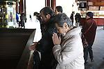 March 18, 2011, Tokyo, Japan - Elderly Japanese people pray at Sensouji Temple in Asakusa, Tokyo, Japan, for earthquake, tsunami, fire and radiation victims of the Tohoku-Kanto Natural Disaster. (Photo by YUTAKA/AFLO)