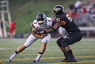 Towson, MD - September 9, 2016: Towson Tigers defensive end D'Sean Cummings (51) sacks St. Francis (Pa) Red Flash quarterback Zack Drayer (7) during game between Towson and St. Francis at Minnegan Field at Johnny Unitas Stadium  in Towson, MD. September 9, 2016.  (Photo by Elliott Brown/Media Images International)