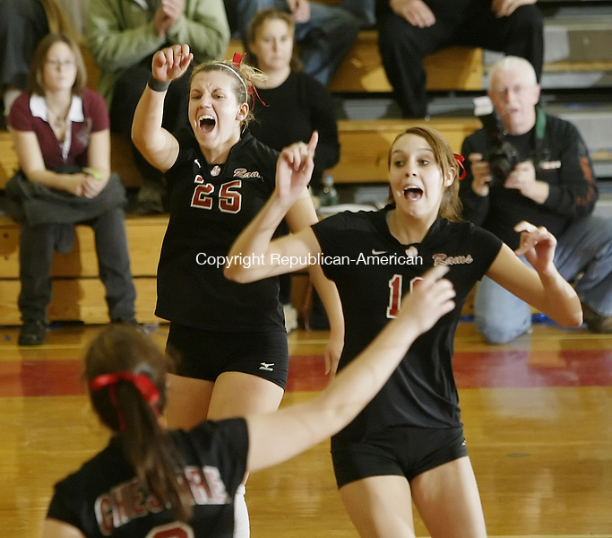 BERLIN, CT, 11/17/07- 111707BZ16- Cheshire's Colleen Dacey (2), bottom, Brittany Grenus (25), and Leah Hirsch and (18) celebrate a point in the final game against New Milford during the class LL final at Berlin High School Saturday night.<br /> Jamison C. Bazinet Republican-American