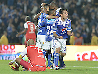BOGOTÁ -COLOMBIA, 29-06-2013. Jose Harrison Otalvaro de Millonarios celebra un gol en contra de Santa Fe durante partido de los cuadrangulares finales, fecha 5, de la Liga Postobón 2013-1 jugado en el estadio el Campín de la ciudad de Bogotá./ Jose Harrison Otalvaro of Millonarios celebrates a goal  against Santa Fe during match of the final quadrangular 5th date of Postobon  League 2013-1 at El Campin stadium in Bogotá city. Photo: VizzorImage/STR