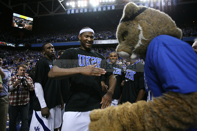 Freshman forward DeMarcus Cousins dances with Wildcat after the UK men's basketball against Drexel at Rupp Arena on Monday, Dec. 21, 2009. The cats celebrated their 2000th win after beating Drexel 88-44. Photo by Adam Wolffbrandt | Staff