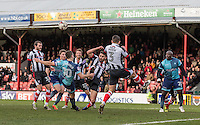 Shaun Pearson of Grimsby Town blocks a Matt Bloomfield of Wycombe Wanderers shot at goal during the Sky Bet League 2 match between Grimsby Town and Wycombe Wanderers at Blundell Park, Cleethorpes, England on 4 March 2017. Photo by Andy Rowland / PRiME Media Images.