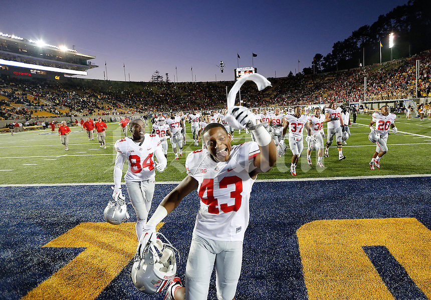 Ohio State Buckeyes punter Darron Lee (43) celebrates after the NCAA football game at Memorial Stadium in Berkeley, California,  Saturday afternoon, September 14, 2013. The Ohio State Buckeyes defeated the California Golden Bears 52 - 34. (The Columbus Dispatch / Eamon Queeney)