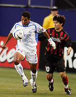 The Wizard's Diego Gutierrez looks to steady the ball as the MetroStars' Joselito Vaca defends. The Kansas City Wizards were defeated by  the NY/NJ MetroStars to a 1 to 0 at Giant's Stadium, East Rutherford, NJ, on May 30, 2004.