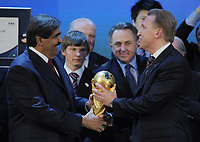 FIFA World Cup Award for 2018 and 2022 Group photo; The Winner Emir from Qatar HH Sheikh Hamad am Khalifa Al Thani left with Russia Vice Prime Ministers Igor Shuvalov Russia right with World Cup Trophy; On April 6th 2020, in addition to Ricardo Teixeira, the former president of the Brazilian Football Confederation and the now-deceased ex-COMNEBOL president Nicolas Leoz and a co-conspirator, two former Fox employees have been indicted as part of the investigation into corruption by US official, which claims that Russia and Qatar offered and paid bribes to secure votes in the process that saw them awarded the 2018 and 2022 World Cups,  an indictment in the United States alleges. The document, was brought by federal prosecutors in New York as part of the long-running investigation into corruption surrounding football's governing body
