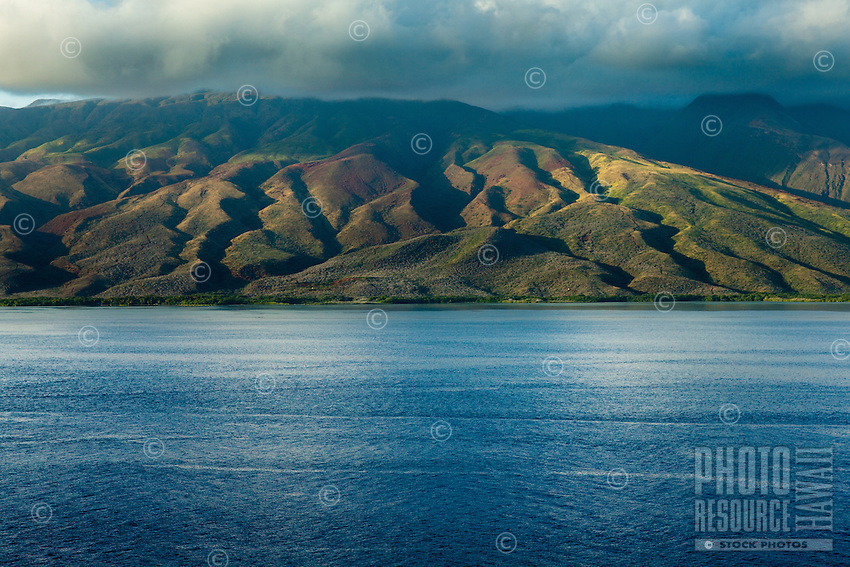 The mountains of Moloka'i right before sunset, as viewed from between Moloka'i and Maui.