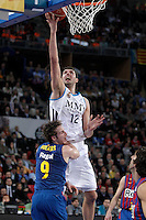 Real Madrid's Nikola Mirotic (f) and FC Barcelona Regal's Marcelinho Huertas during Spanish Basketball King's Cup match.February 07,2013. (ALTERPHOTOS/Acero) /Nortephoto