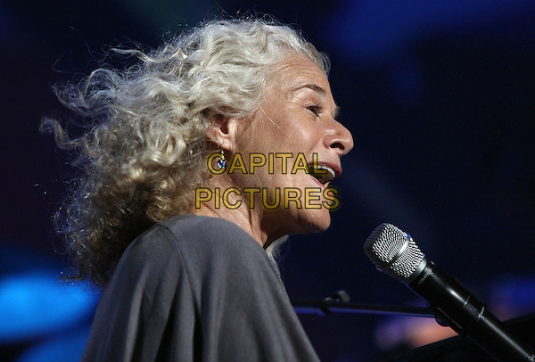 "CAROLE KING.performing at ""Feel Free"" a National Parks Celebration Concert in Central Park, New York, NY, USA,.23 September 2009..music live on stage concert gig singing portrait headshot grey gray microphone profile side.CAP/ADM/PZ.©Paul Zimmerman/AdMedia/Capital Pictures."