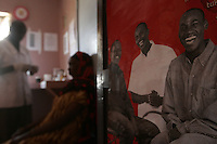 Mama Guyo, a Bornan Elder, is tested by VCT Counsellor Eliud Mirithi at the Pepo La Tumaini Jangwani Liverpool VCT Center in Isiolo, Kenya., on Monday, October  22, 2007.  The Voluntary Counseling and Testing Centeoffers free HIV/AIDS testing councelling to an average of 100 patients er month, with an average of 10% testing positive for HIV/AIDS  (Photo by Bryce Yukio Adolphson, © 2007)