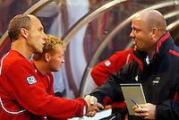 MetroStars' head coach Bob Bradley shakes hands with his counterpart, Burn head coach Colin Clarke before the start of the game. The Dallas Burn shut out  the NY/NJ MetroStars 2 to 0 at Giant's Stadium, East Rutherford, NJ, on June 5, 2004.