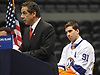 New York Islander captain John Tavares, right, watches New York State Governor Andrew Cuomo address the media during a news conference at Nassau Coliseum on Monday, Jan. 29, 2018. Cuomo announced the site will host a portion of Islanders home games over the next three seasons as the team's new arena at Belmont is being constructed.