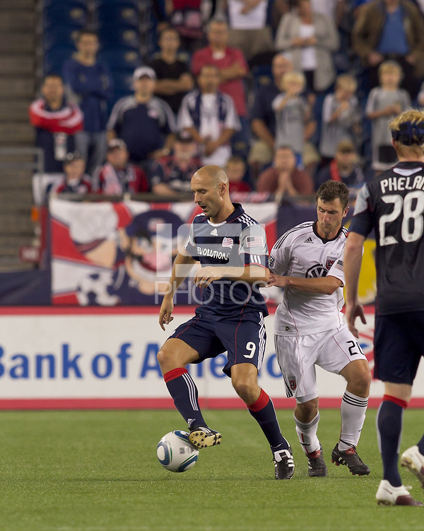 Second half substitute New England Revolution forward Ilica Stojica (9) dribbles as DC United midfielder Stephen King (20) defends. The New England Revolution defeated DC United, 1-0, at Gillette Stadium on August 7, 2010.