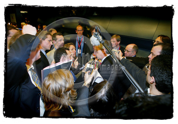 BRUSSELS - BELGIUM - 22 MARCH 2005 --Journalist surrounding Jean Clude KUNKER, Prime Minister og Luxembourg, with their tape recorders and mirophones.--  PHOTO: ERIK LUNTANG / EUP-IMAGES