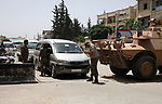 Syrian members of the Police and general security, search cars as they secure the area, at the entrance to the market in Azaz city, north of Aleppo, Syria, May 18, 2020. Photo by Nayef ALaboud