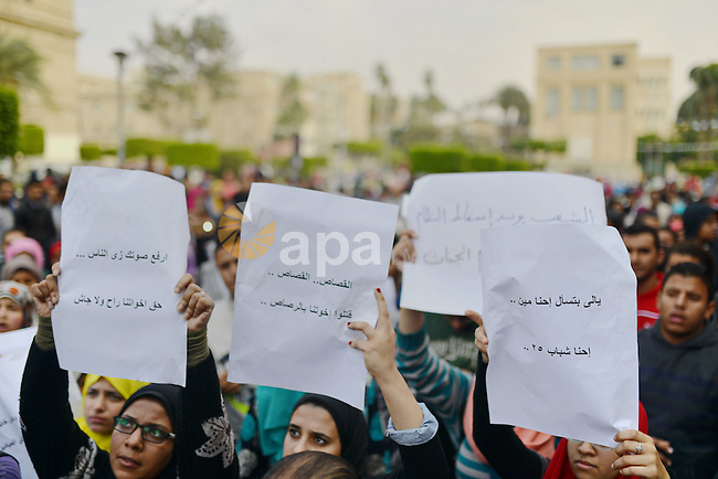 Egyptian anti-Mubarak students chant slogans one day after a court dismissed murder charges against former president Hosni Mubarak at Cairo University, Egypt, 30 November 2014. Two people were killed in clashes between police and demonstrators in Cairo after the court verdict. Nine people were wounded in the unrest that erupted near central Cairo's Tahrir Square, the epicenter of a 2011 uprising against Mubarak. Photo by Amr Sayed