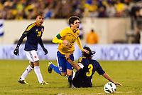 Oscar (10) of Brazil is fouled by Mario Alberto Yepes (3) of Colombia. Brazil (BRA) and Colombia (COL) played to a 1-1 tie during international friendly at MetLife Stadium in East Rutherford, NJ, on November 14, 2012.