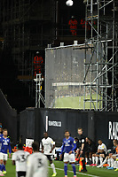 10th July 2020; Craven Cottage, London, England; English Championship Football, Fulham versus Cardiff City; Work men watch the game from the scaffolding