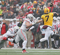 Ohio State Buckeyes defensive lineman Joey Bosa (97) pressures Minnesota Golden Gophers quarterback Mitch Leidner (7) in first half action at TCF Bank Stadium on November 15, 2014. (Chris Russell/Dispatch Photo)