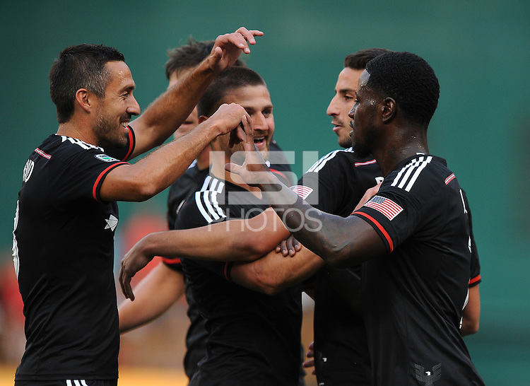 Washington D.C. - July 30, 2014: Eddie Johnson (7) of D.C. United celebrates worth teammates his score.  D.C. United defeated the Toronto FC 3-1 during a Major League Soccer match for the 2014 season at RFK Stadium.