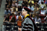 Spring Graduation - first ceremony for the College of Education and the College of Business; mace-bearer Grisham Master Teacher winner history professor Jim Giesen during the commencement ceremony at Humphrey Coliseum.<br />