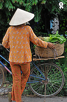 Woman in traditional dress holding bike (Licence this image exclusively with Getty: http://www.gettyimages.com/detail/83154245 )