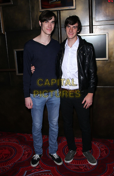 MARSTON HEFNER,  COOPER HEFNER .Claire Sinclair celebrates her premiere with MGM Grand's Crazy Horse Paris at the MGM Grand Resort Hotel and Casino, Las Vegas, Nevada, USA, .21st October 2010..full length jeans black jacket leather jumper shirt white trainers  family .CAP/ADM/MJT.© MJT/AdMedia/Capital Pictures.