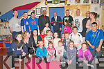 Official Opening : Minister for the Arts, Heritage & the Gaeltach, Jimmy Deenihan, TD cutting the ribbon at the official opening of the World Kickboxing Federation's Irish Academy in Listowel Business Park, Listowel on Monday night last.In the phot is Jimmy Byrne, Manager KWF England Scotland & Wales & Mick O'Brien, Manager WWF Ireland from Listowel.