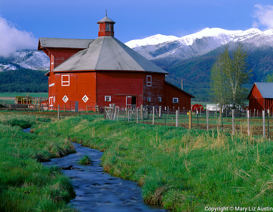 Wallowa County, OR     <br /> A red octagonal barn in the Wallowa Valley (built in 1906) with the Wallowa Mountains in the distance