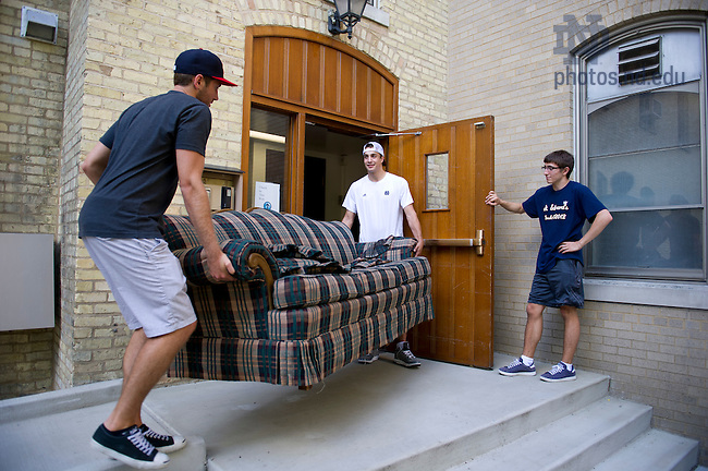 August 17, 2012; Orientation staff members, Greyson Wayer  (left) and Will Barth Jr. carry a couch into a dorm at  St. Edward's Hall during move in day.  Photo by Barbara Johnston/University of Notre Dame