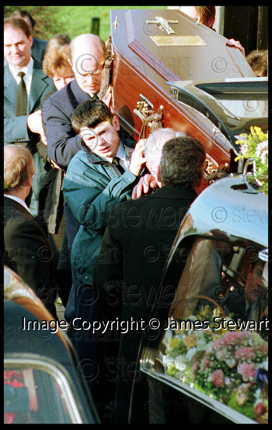 5th November 98   .Copyright Pic : James Stewart   .16th Dec 94 : JAMES GIBSON CARRIES THE COFFIN OF ONE OF HIS TWO FRIENDS WHO DIED AFTER THEIR CAR WENT INTO THE RIVER AT TWECHAR AFTER THE BRIDGE COLLAPSED IN FLOODS.... JAMES GIBSON IS NOW SUING THE POLICE FOR NOT REACTING TO THE DANGERS OF THE COLLAPSED BRIDGE.......Payments to :-.James Stewart Photo Agency, Stewart House, Stewart Road, Falkirk. FK2 7AS      Vat Reg No. 607 6932 25.Office : 01324 630007        Mobile : 0421 416997.E-mail : JSpics@aol.com.If you require further information then contact Jim Stewart on any of the numbers above.........