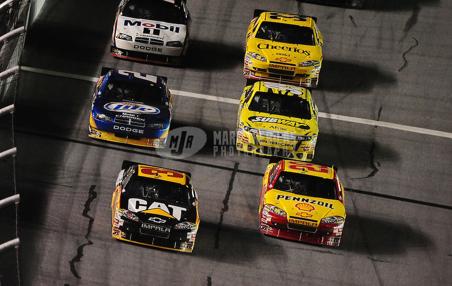 Jul. 3, 2010; Daytona Beach, FL, USA; NASCAR Sprint Cup Series driver Jeff Burton (31) races alongside teammate Kevin Harvick (29) for the lead during the Coke Zero 400 at Daytona International Speedway. Mandatory Credit: Mark J. Rebilas-
