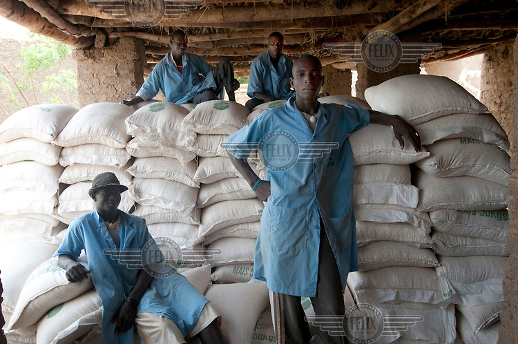 Porters wait to deliver sacks of corn to beneficiaries at a Plan food distribution centre in Tillaberi. A drought in southern Niger has affected up to 8 million people.