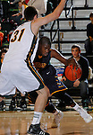 SPEARFISH, SD - DECEMBER 21, 2013:  Jon Conley #4 of Regis drives on Cameron Anderson #31 of Black Hills State during their Rocky Mountain Athletic Conference game Saturday at the Donald E. Young Center in Spearfish, S.D.  (Photo by Dick Carlson/Inertia)