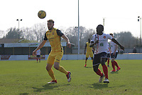 Bradley Warner of Hornchurch gets in a cross from Kofi Gyebi of Witham Brad during Witham Town vs AFC Hornchurch, Bostik League Division 1 North Football at Spa Road on 14th April 2018