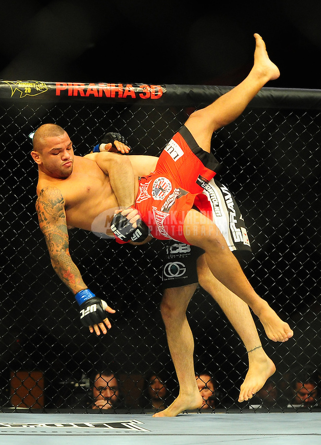 Aug. 7, 2010; Oakland, CA, USA; UFC fighter Jon Fitch (bottom) lifts Thiago Alves (top) during the welterweight bout in UFC 117 at the Oracle Arena. Mandatory Credit: Mark J. Rebilas
