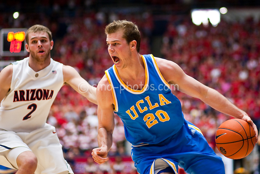Feb 14, 2009; Tucson, AZ, USA; UCLA Bruins forward Michael Roll (20) dribbles past Arizona Wildcats guard Zane Johnson (2) in the first half of a game at the McKale Center.  The Wildcats won the game 84-72 to break an eight-game losing streak against the Bruins and win their seventh game in a row.